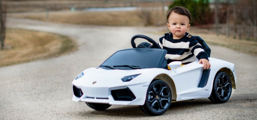 Image of baby driving a white car