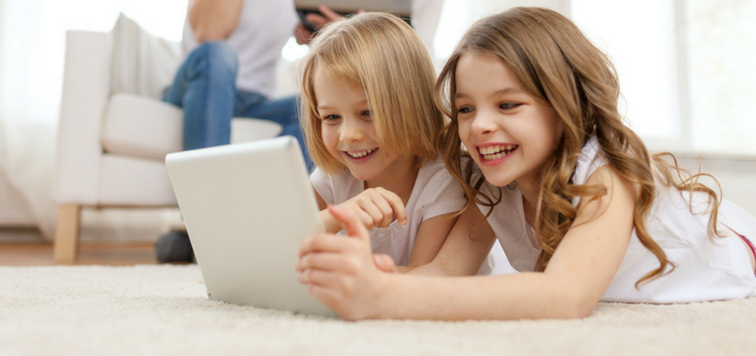 Image of kids on a tablet