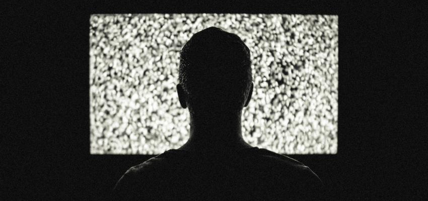 Image of man watching blank screen